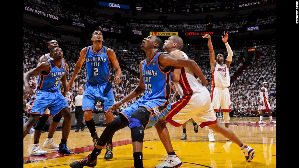 Thunder players Serge Ibaka No. 9, Thabo Sefolosha No. 2 and Kevin Durant No. 35 wait for a rebound after a free-throw by Dwyane Wade No. 3 of the Heat.