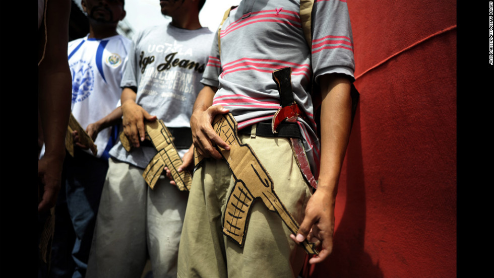 Mara Salvatrucha gang members prepare for a performance Tuesday at the prison of Ciudad Barrios in El Salvador.