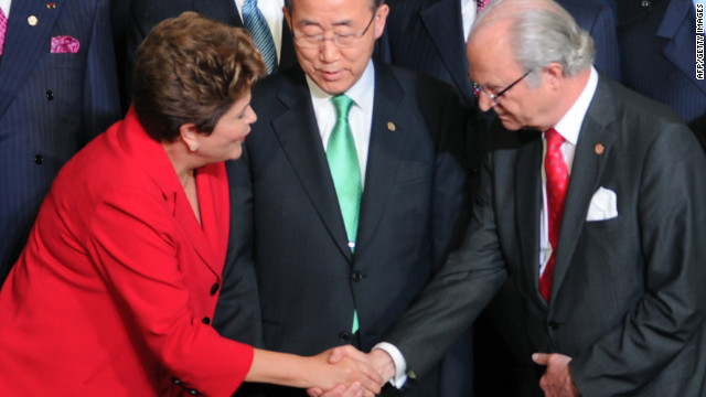 Brazil's President Dilma Rousseff, left, greets Sweden's King Carl Gustaf as U.N. Secretary-General Ban Ki-moon looks on.