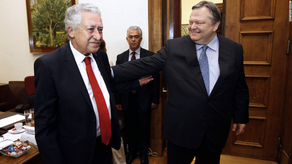 Venizelos, right, shakes hands with the leader of the Democratic Party of the Left, Fotis Kouvelis, at the Greek parliament on June 19, 2012.  Venizelos said discussions would continue Wednesday into the exact makeup of the new government.
