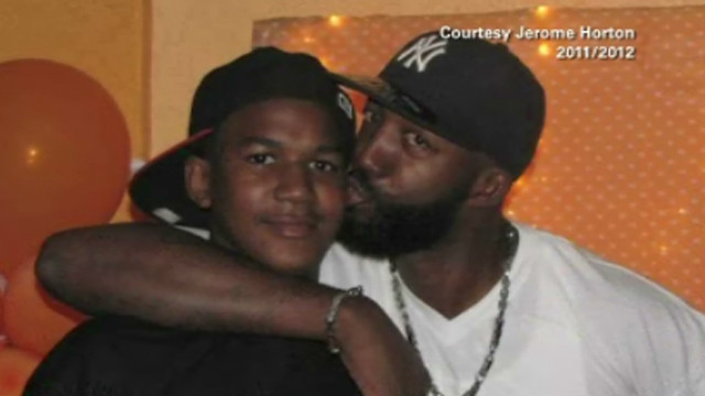Family photo of Trayvon Martin and his father