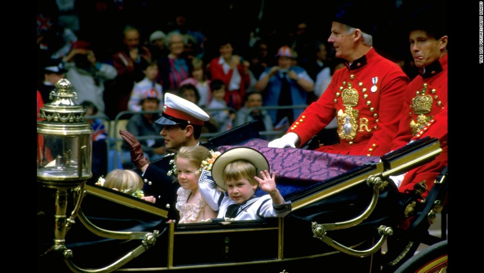 Prince William waves from a carriage en route to the wedding of Prince Andrew and Sarah Ferguson on July 23, 1986.