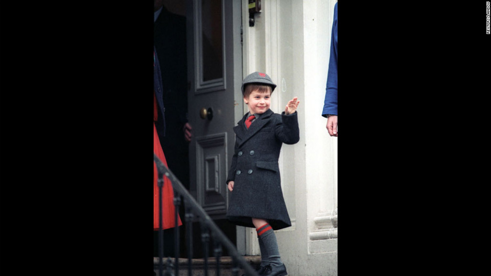 Wearing a regulation school uniform, Prince William waves to the press on his first day at Wetherby School on January 15, 1987.