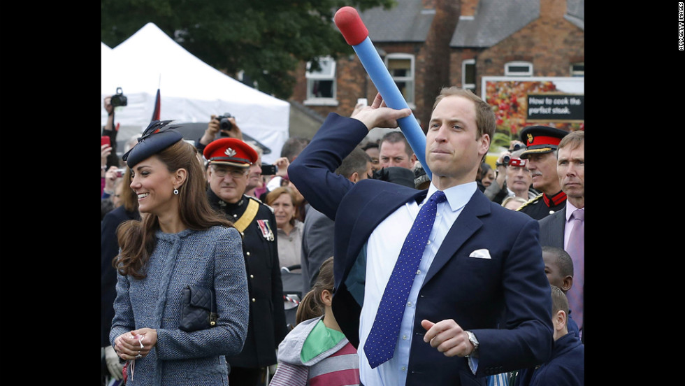 Prince William throws a foam javelin as his wife, now the Duchess of Cambridge, stands at his side during a visit to Nottingham, England, on June 13, 2012. The couple were in the city as part of Queen Elizabeth II's diamond jubilee tour, marking the 60th anniversary of her accession to the throne.
