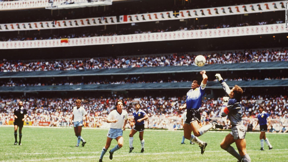 "One of the most controversial moments in soccer history as Diego Maradona scored with his hand for Argentina against England in the World Cup quarterfinal. The goal was allowed to stand and Maradona added a brilliant second to ensure a 2-1 win for Argentina. The game was played just four years after the Falklands War had ended. Maradona spoke of his side's win as ""revenge"" and claimed his goal was scored by the ""Hand of God."" Argentina went on to win the World Cup."