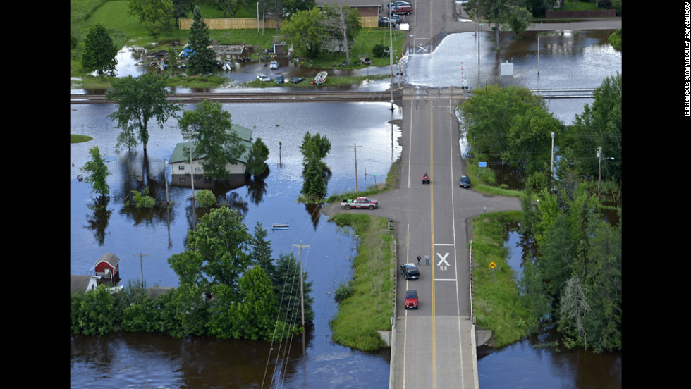 Travel remains difficult in parts of northeastern Minnesota after intense flash flooding. Here, the St. Louis River rises in Brookston, near Cloquet, on Thursday, June 21.