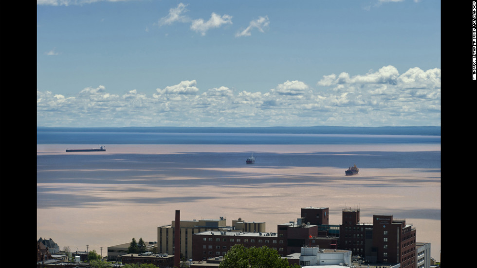 Flood runoff leaves mud in Lake Superior in this view looking east from Duluth toward Wisconsin. Heavy storms this week dropped as much as 10 inches of rain on Duluth and neighboring communities.