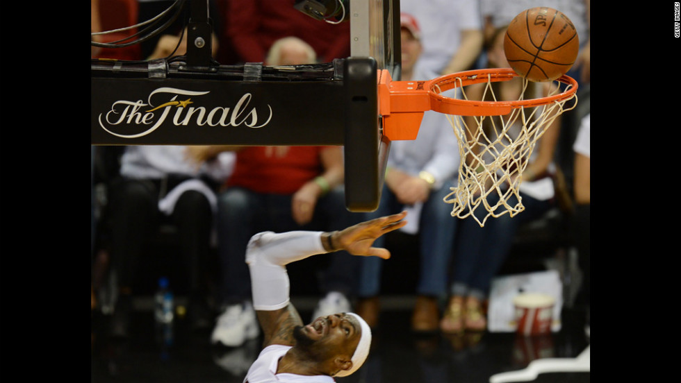 LeBron James of the Heat scores against the Thunder.