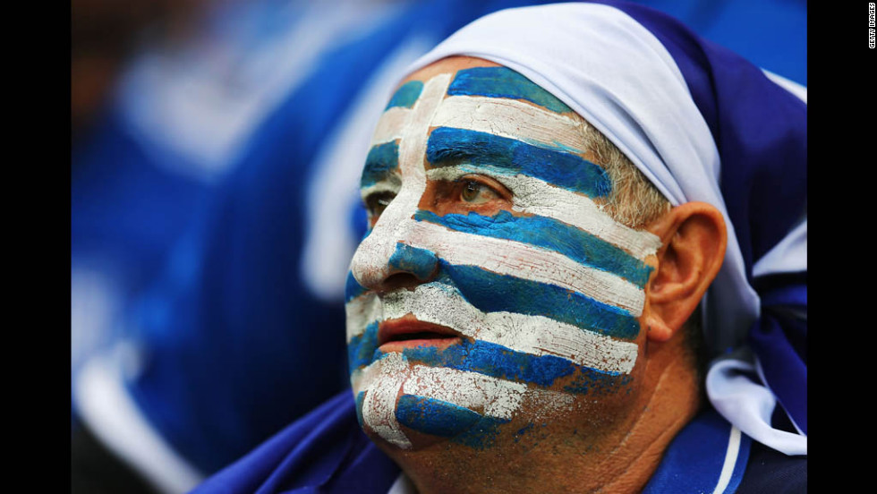 A Greek fan watches the quarterfinal match against Germany on Friday.