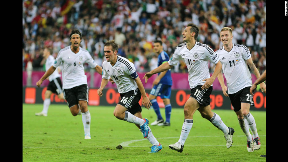 Philipp Lahm, Marco Reus and Miroslav Klose celebrate a goal that put Germany ahead of Greece 1-0 in Friday's quarterfinal match.