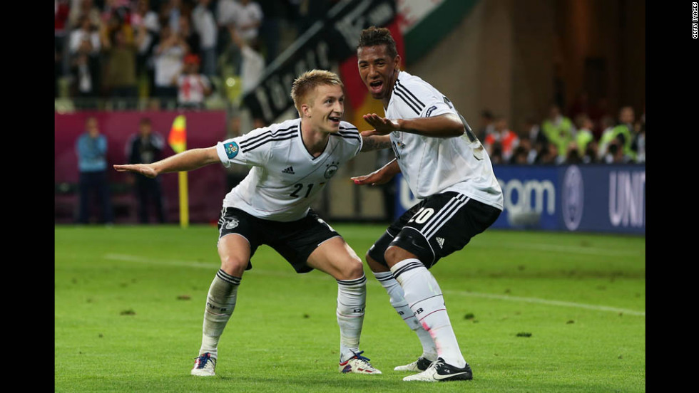 Germany's Marco Reus celebrates scoring the team's fourth goal with Jerome Boateng during the Euro 2012 quarter-final match against Greece at The Municipal Stadium in Gdansk, Poland.
