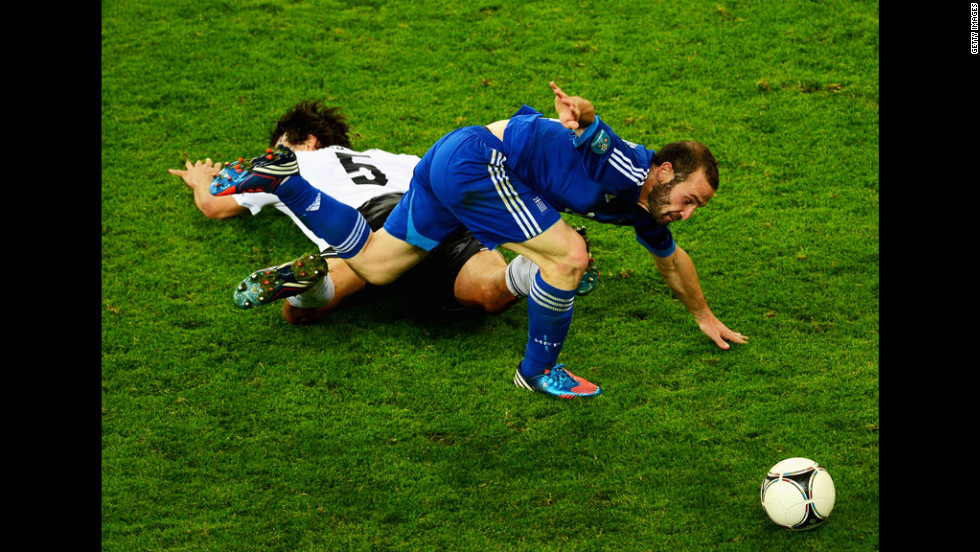 Dimitris Salpigidis of Greece fouls Mats Hummels of Germany during the quarterfinal match between Germany and Greece.