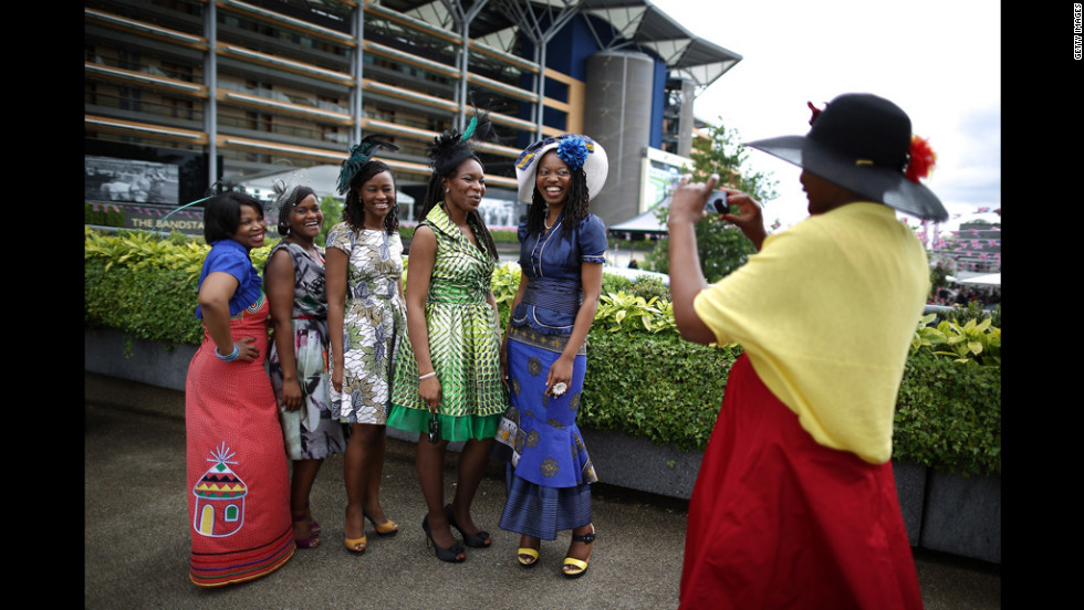 A visitor to Royal Ascot photographs her friends.