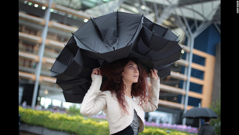 Larisa Katz shows off an umbrella hat design at Royal Ascot.