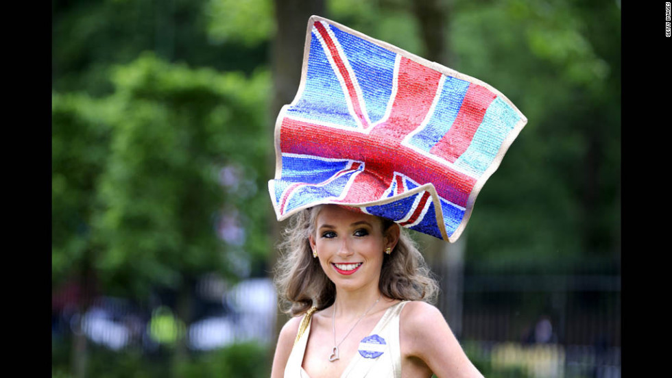 A large hat resembling the British flag sits atop a woman's head.