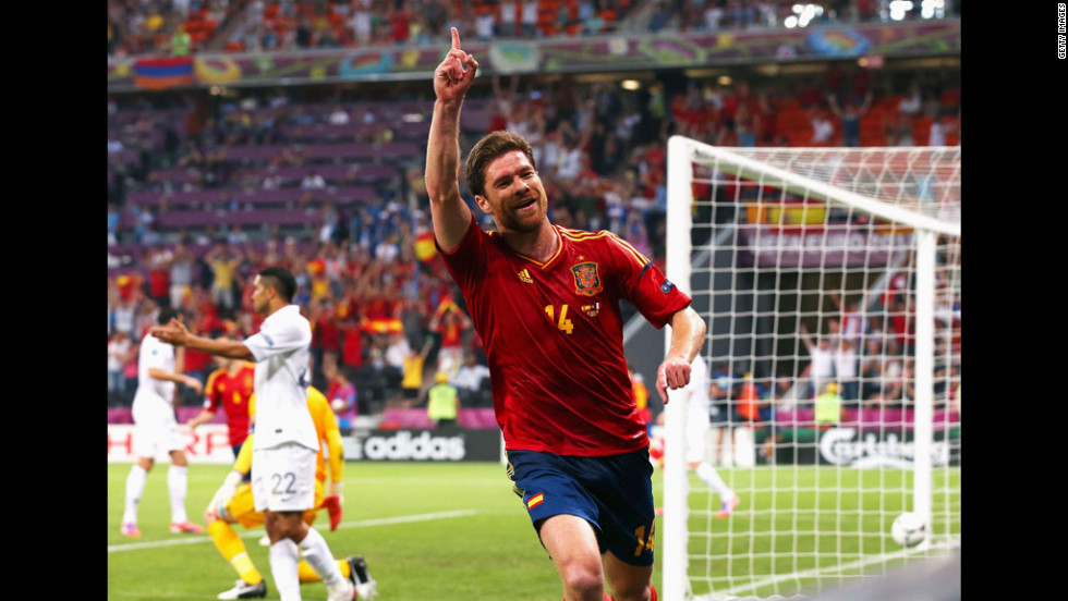 Xabi Alonso of Spain celebrates after scoring the first goal during the quarterfinal match between Spain and France.