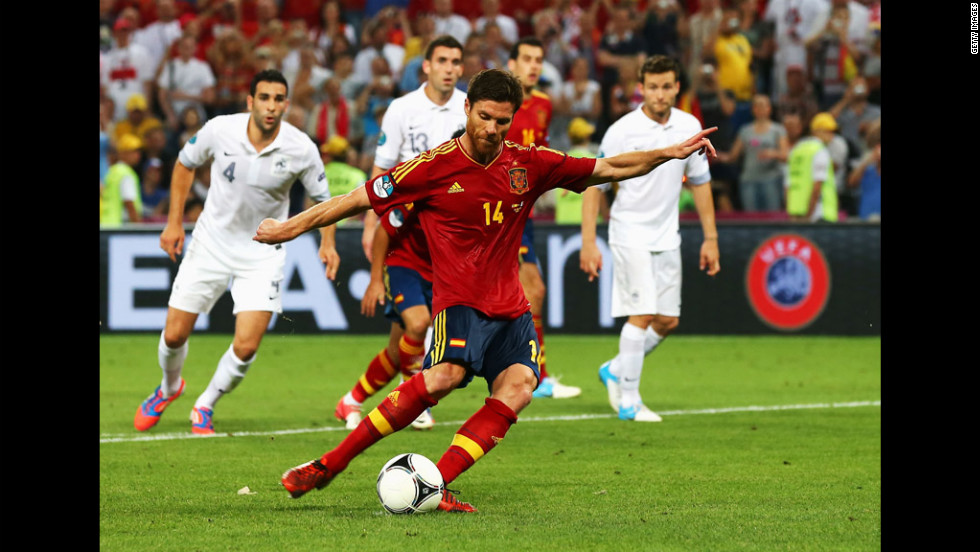 Xabi Alonso of Spain scores the second goal from the penalty spot during the quarter final match between Spain and France at Donbass Arena on Saturday, June 23, in Donetsk, Ukraine.
