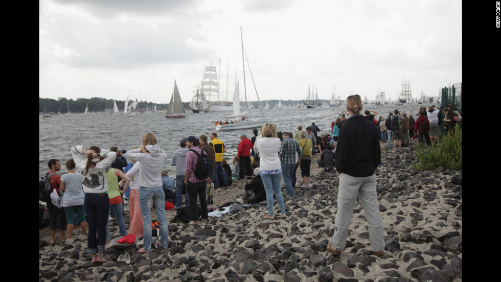Visitors watch the parade, the highlight of the weeklong Kieler Woche annual sailing festival, which this year is celebrating its 130th anniversary. It ends Sunday.