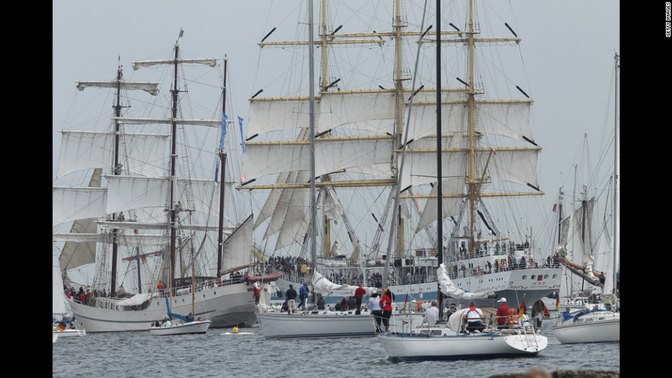 Tall ships participating in the Windjammer Parade head out to sea.