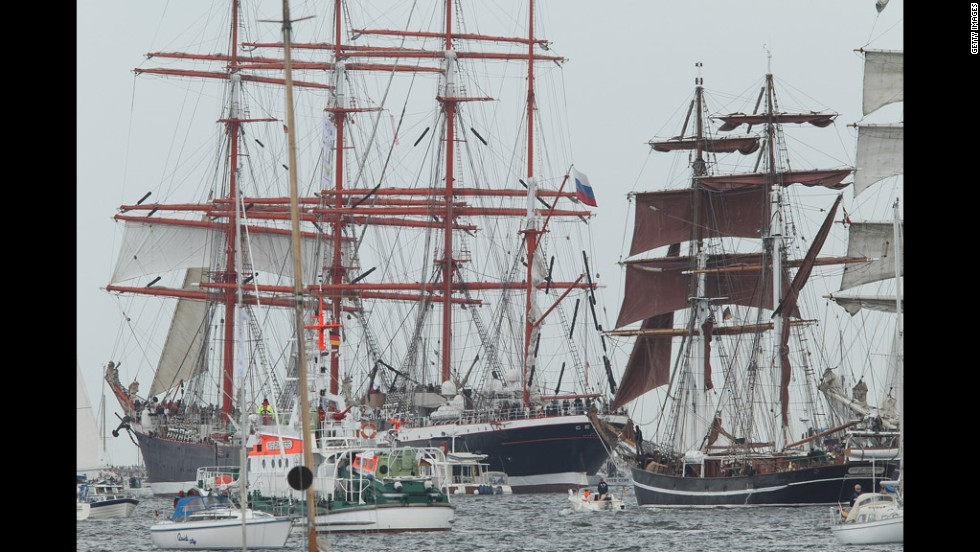 Tall ships participating in the Windjammer Parade head out sea.