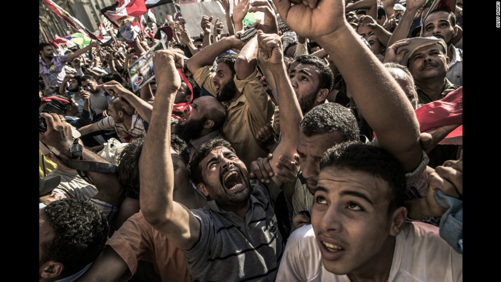 Egyptians celebrate the election of Morsi after he won 51% of the vote to defeat Shafik.