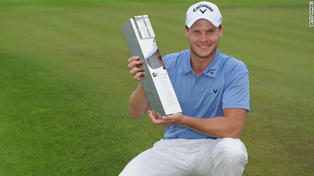 Danny Willett with the winning trophy from the BMW International Open in Cologne.