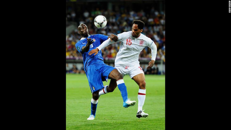 Mario Balotelli of Italy challenges Joleon Lescott of England.