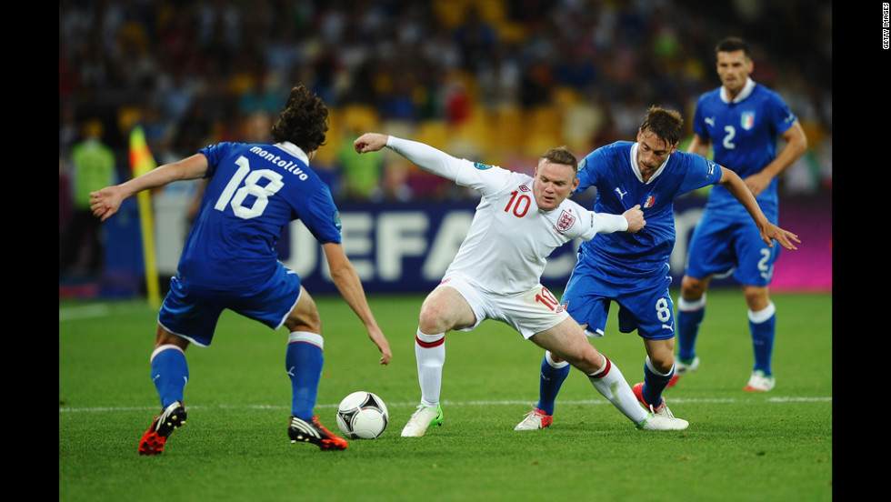England's Wayne Rooney maneuvers against Italy.