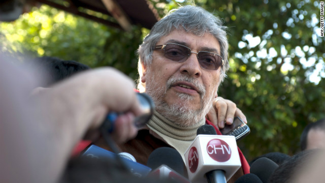 Former Paraguayan President Fernando Lugo talks to journalists in front of his house in Asuncion on June 24, 2012