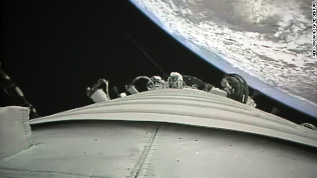 A view from Shenzhou-9 spacecraft as it prepares to link with the Tiangong-1 module.