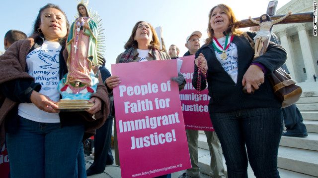 Protesters demonstrate against Arizona's SB1070 law in front of the Supreme Court on April 25 in Washington.