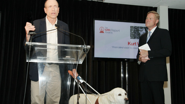 Kurt Weston and his guide dog Ambrose accept the Personal Story award from CNN International anchor Michael Holmes at Saturday's iReport Awards ceremony in Atlanta, Georgia.