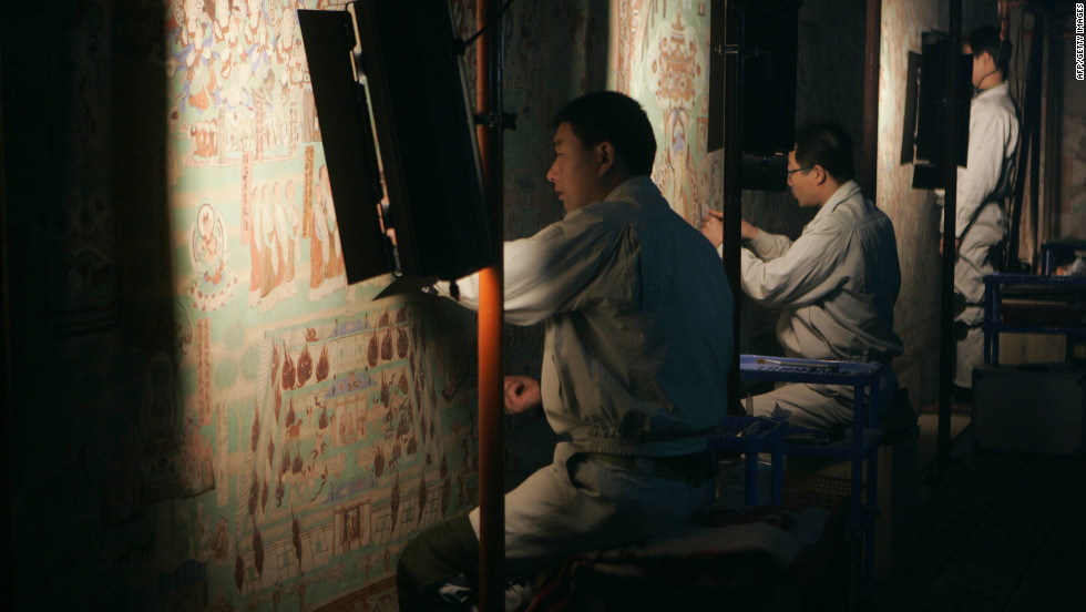 The cave frescoes were created as eternal tributes to Buddha but are today fading away because of age and tourism pressures.