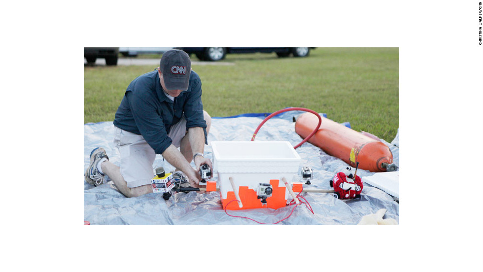"Erickson attaches a waterproof GoPro camera to a Styrofoam cooler. The cameras cost about $300 a piece and the cooler about $2. The tank on the right was used to fill the balloon with helium.The vehicle was dubbed ""Yeager,"" after the famous Air Force test pilot Chuck Yeager."