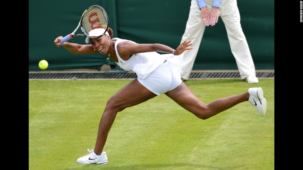 Venus Williams plays a shot during her first round women's singles match against Russia's Elena Vesnina on Monday, June 25, during the first round at Wimbledon. Williams lost the match, her earliest exit from the tournament in 15 years.