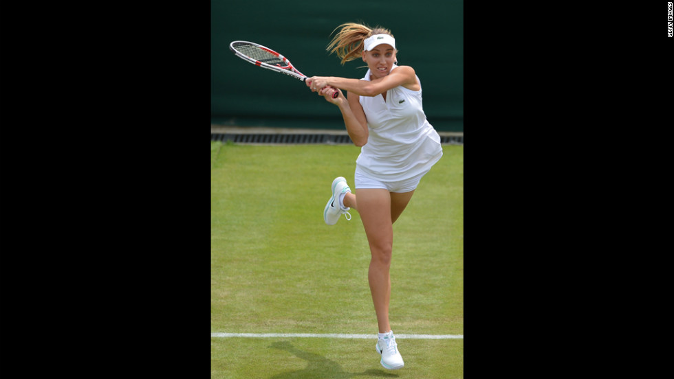 Vesnina plays a shot during her first round women's singles match against WIlliams.