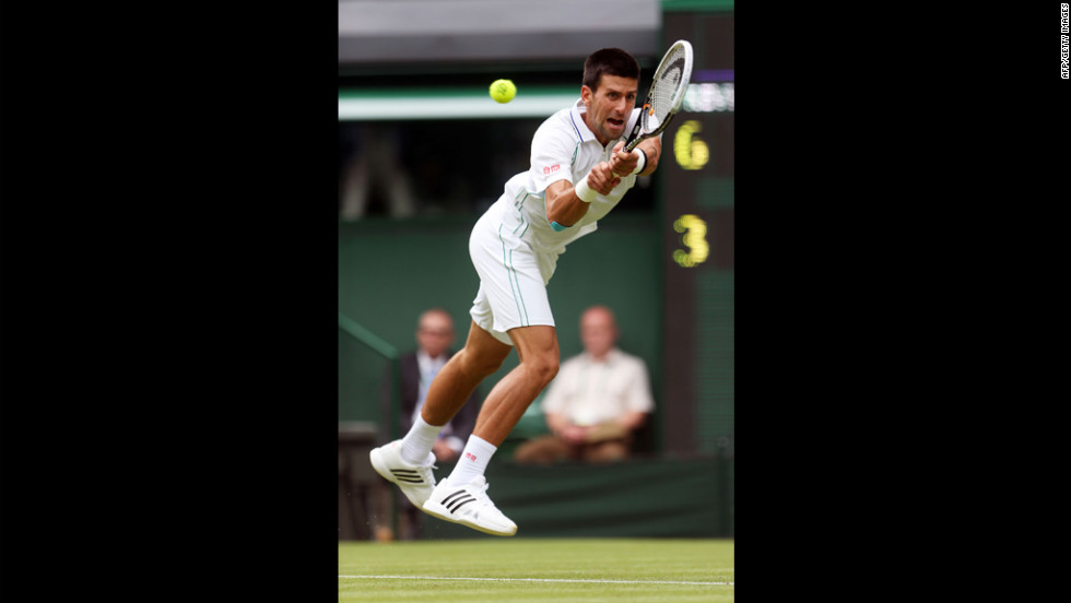 Serbia's Novak Djokovic fires a backhand return against Juan Carlos Ferrero of Spain on June 25.