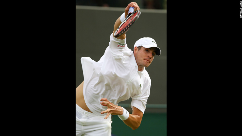 America's John Isner returns a shot during his men's singles first-round match against Alejandro Falla of Colombia June 25.