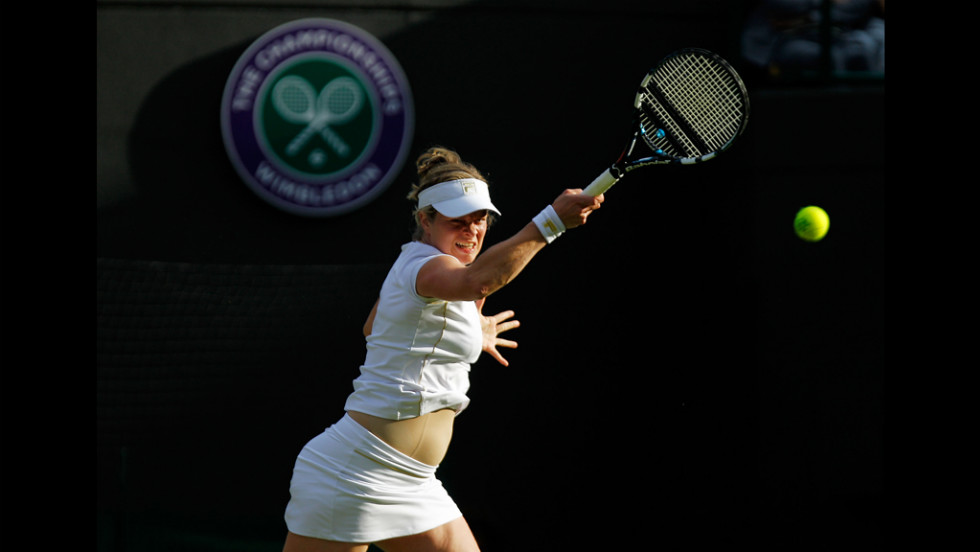 Clijsters hits a backhand return.