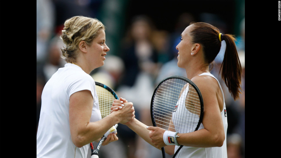 Kim Clijsters of Belgium, left, celebrates match point and is congratulated by Jelena Jankovic of Serbia after their women's singles first round match.