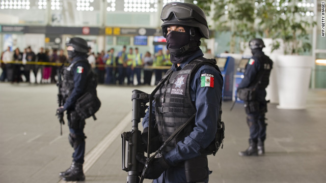 Federal police officers stand guard at the Benito Juarez International Airport in Mexico City on Monday.