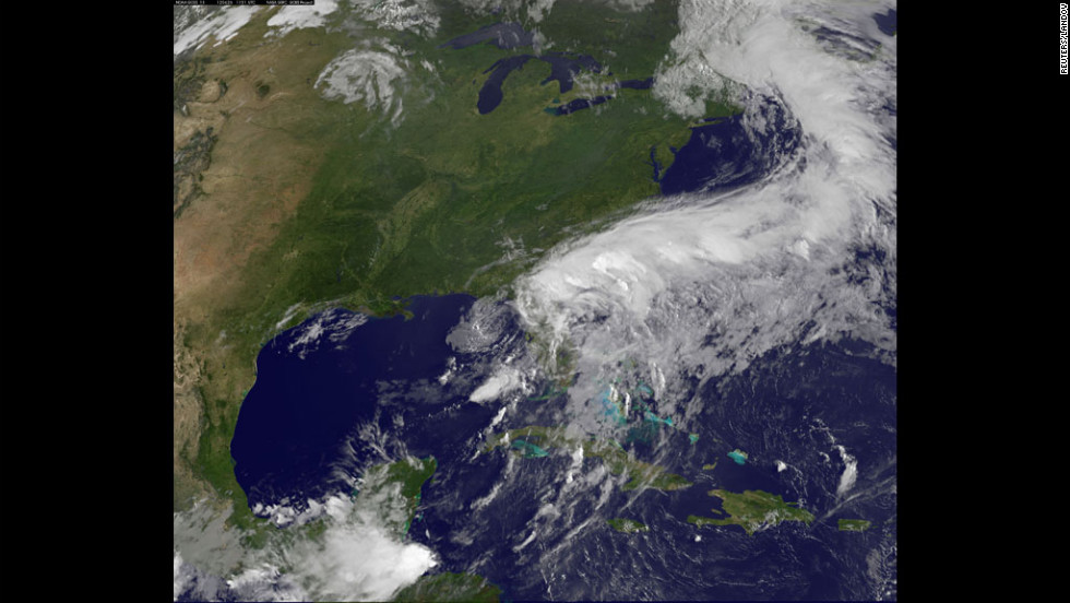 Tropical Storm Debby appears in a satellite image on Tuesday, June 26. Forecasters warn Debby could bring another 8 inches of rain to northern Florida as it heads from the Gulf of Mexico to the Atlantic Ocean.