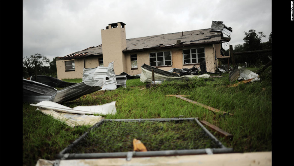 A house in Lecanto, Florida, is partially destroyed after a tornado associated with Tropical Storm Debby passed through over the weekend. The slow-moving Debby has buffeted parts of Florida with driving rains and high winds as it hovers off the Gulf of Mexico.