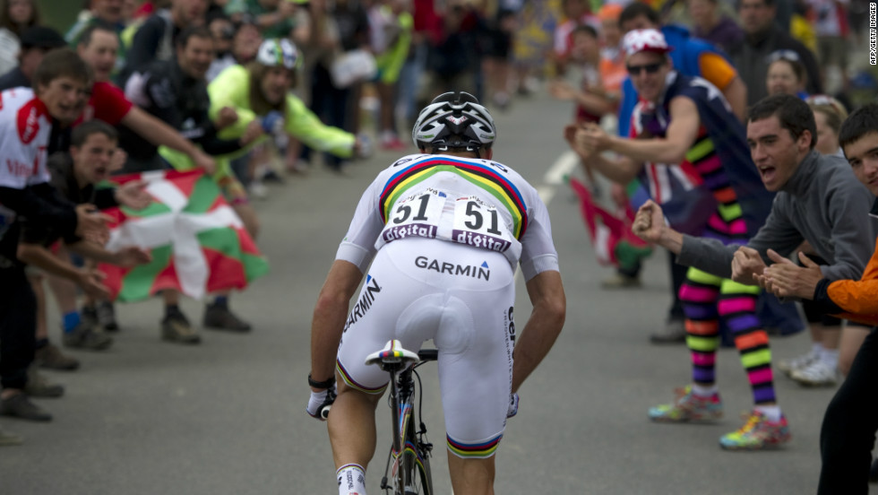 Thor Hushovd, the 2010 world road champion, rides up a mountain and into a phalanx of supporters during last year's Tour.
