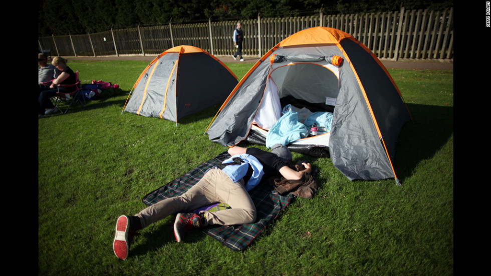 A tennis fan camps out to get a ticket to the first day of matches at Wimbledon June 25.