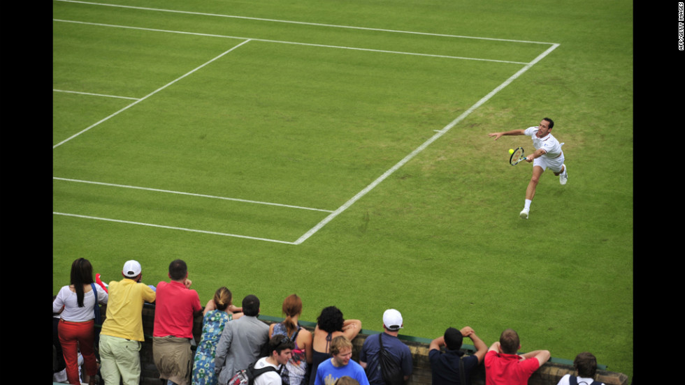 France's Michael Llodra plays a forehand shot during his first-round men's singles match against Italy's Fabio Fognini on June 25.