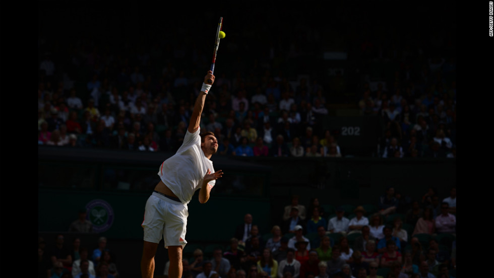 Latvia's Ernests Gulbis serves to the Czech Republic's Tomas Berdych on June 25.