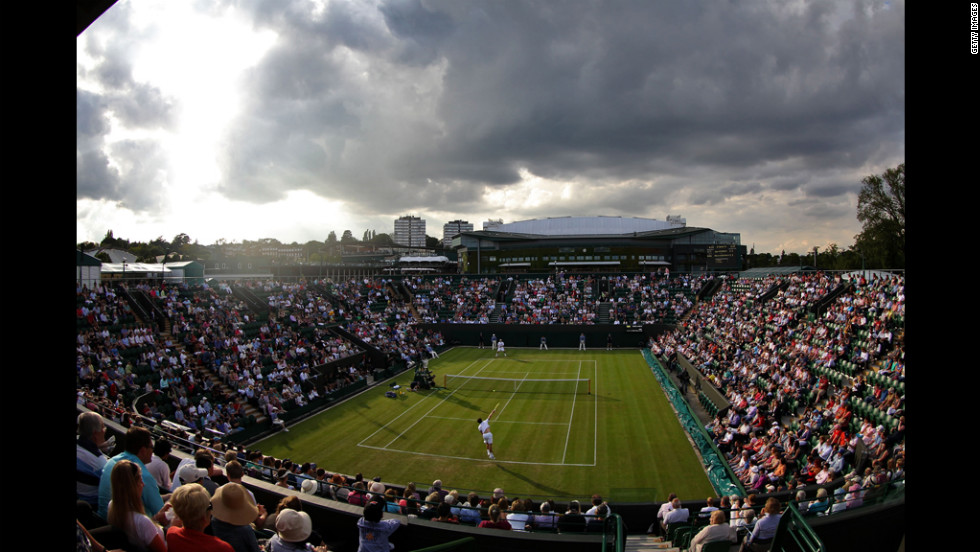 Oliver Golding of Great Britain serves against Igor Andreev of Russia on June 25 on court 2.