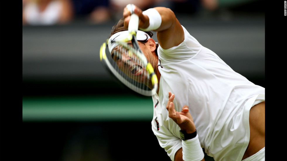 Rafael Nadal of Spain serves to Brazil's Thomaz Bellucci during his men's singles first-round match on June 26.