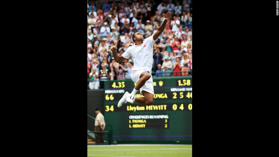 Tsonga, of France, celebrates after beating Australia's Hewitt during their men's first-round match June 26.